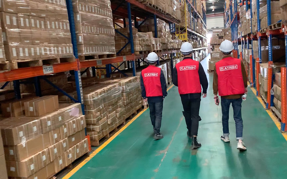 Atrih Tech employees in the stock warehouse