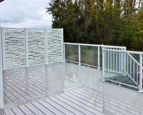 Large PVC deck with white privacy screen