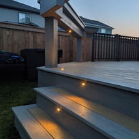 Deck stairs with lighting at night