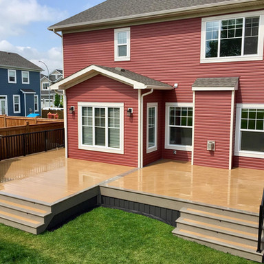 Composite deck with two sets of stairs