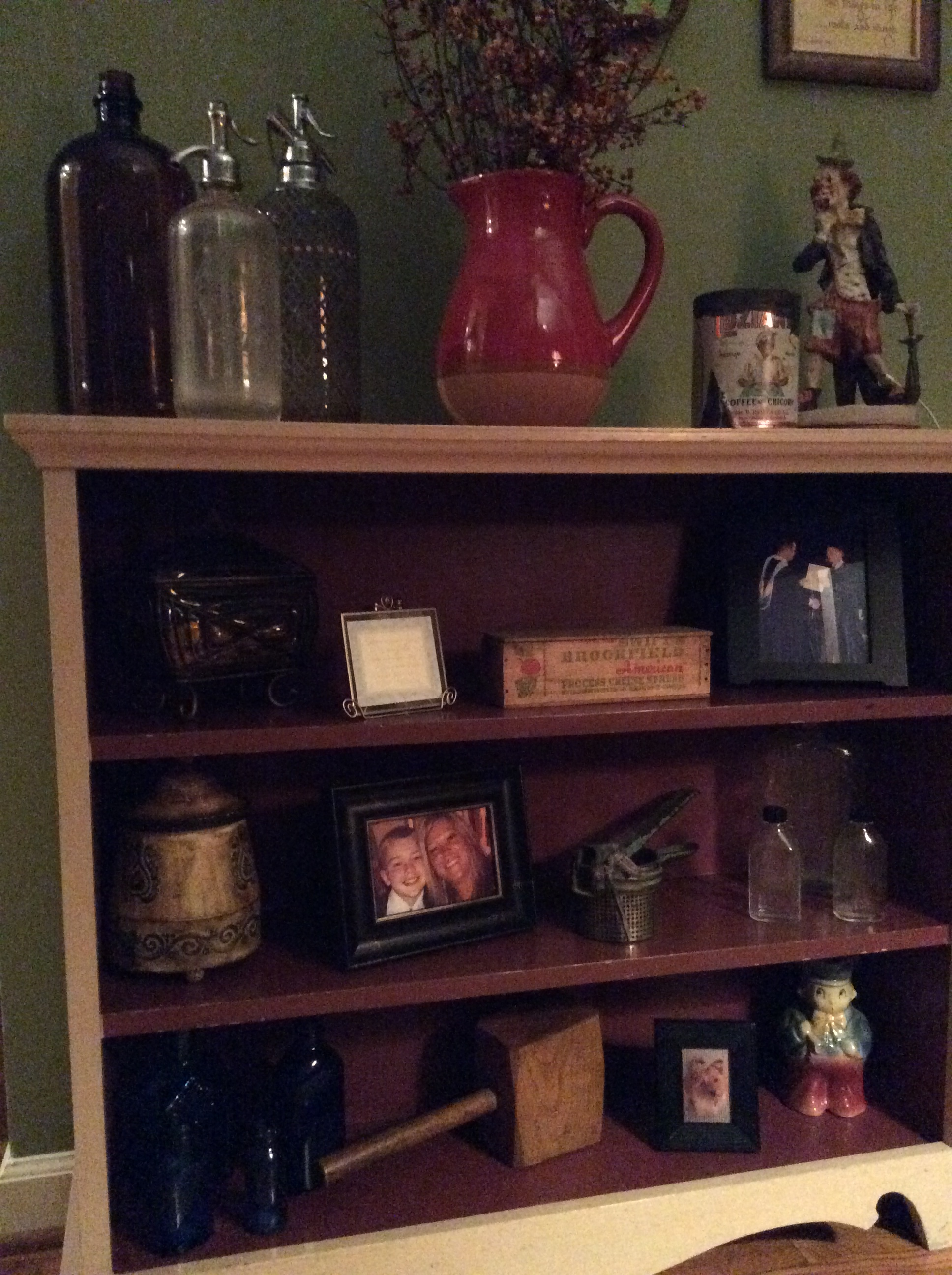 Painted bookcase with collectibles