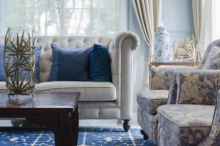 luxury living room with sofa on blue pat