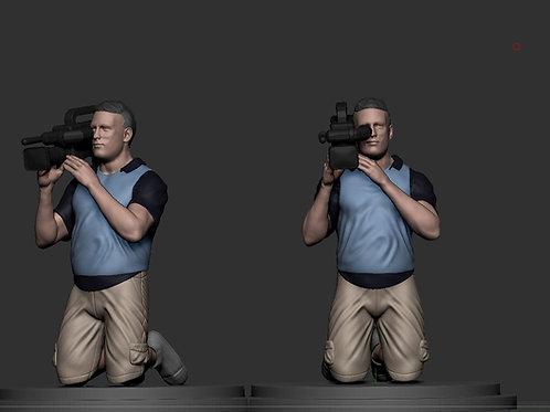 Cameraman on knees