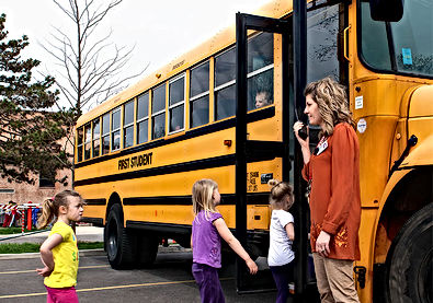 school bus and teacher talking on walkie talkie