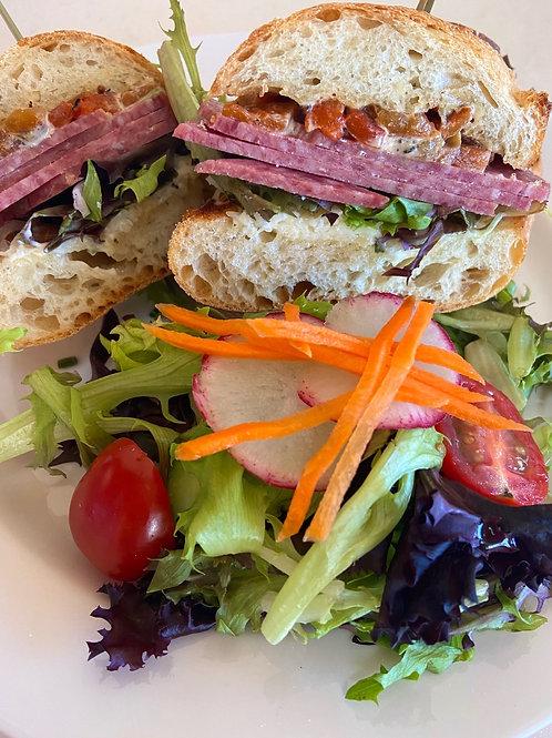 Saucisson Sec sandwich with side salad