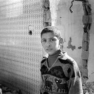 Gaza, Rafah, le 9 décembre 2002.  Chez lui, il y avait une cuisine rose et une salle de bain verte. La maison a été détruite parce qu'elle se trouvait trop près du nouveau mur...   Rafah, le 9 décembre2002.  Chez lui, il y avait une cuisine rose et une salle de bain verte. La maison a été détruite parce qu'elle se trouvait trop près du nouveau mur...