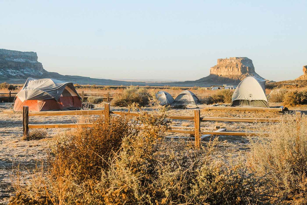 Camping tents at dawn in Chaco Canyon