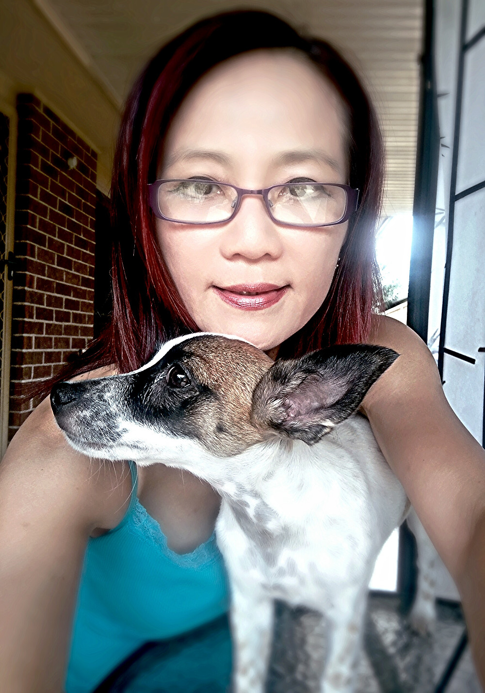 Lush Pet Care lady with small Jack Russell