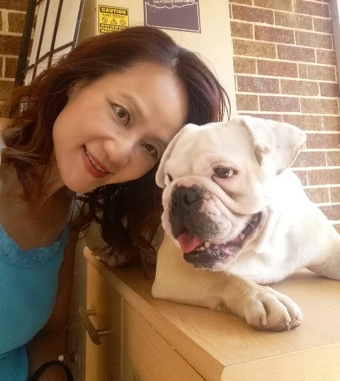 Lush Pet Care lady with small bulldog