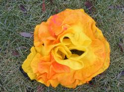 Yellow felt on grass.jpg