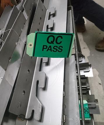 Various metals with green QC PASS tag