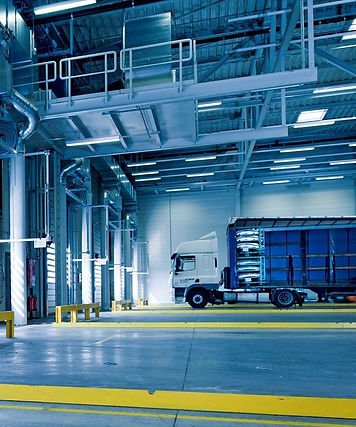 Lorry with cargo in warehouse