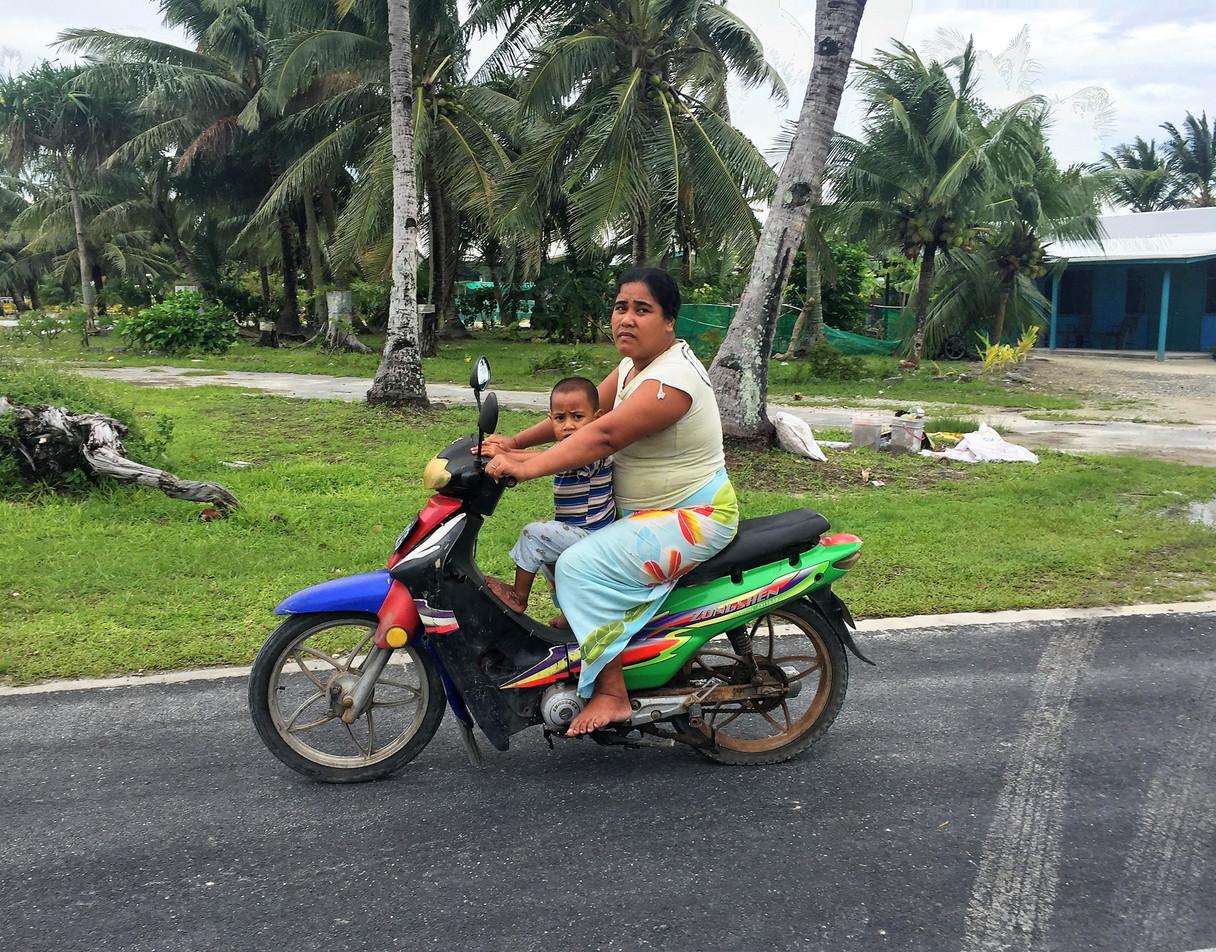 Tuvalu_Mother_with_kid_on_bike.JPG
