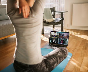 Fitness coach teaching yoga online to gr