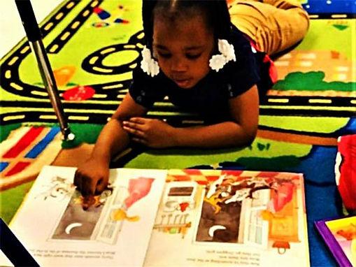 girl on mat reading.jpg