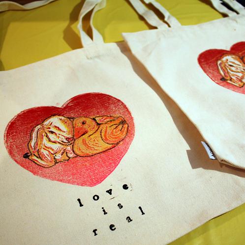 love is real tote bag