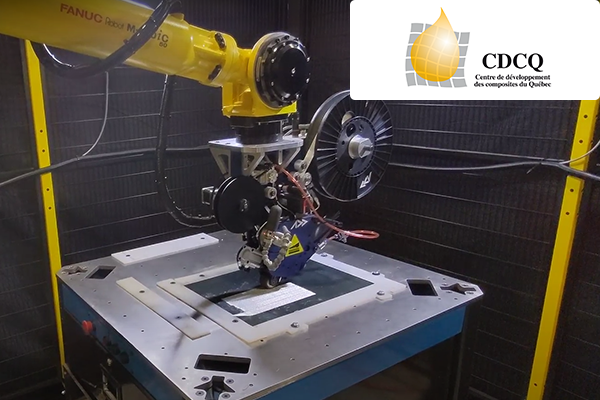 Robotic cell developed by the Quebec firm Effman composed of a robot (FANUC), and an automated fiber placement head (Addcomposites)