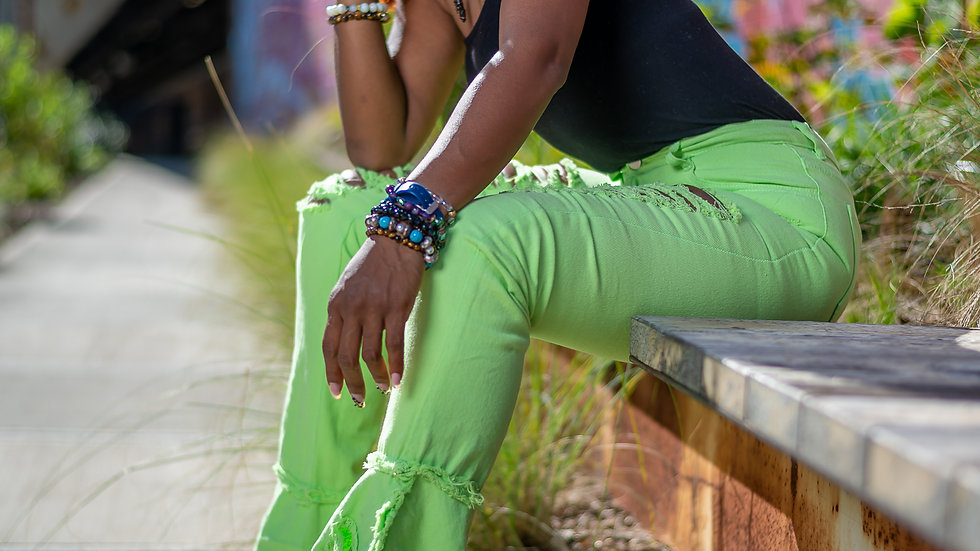Neon green distressed bell bottom jeans