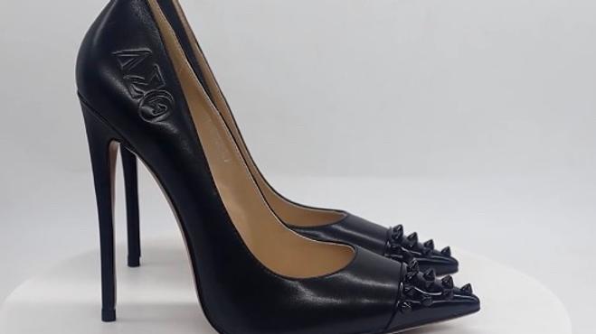 Black/Black ΔΣΘ Debossed pumps with black spikes