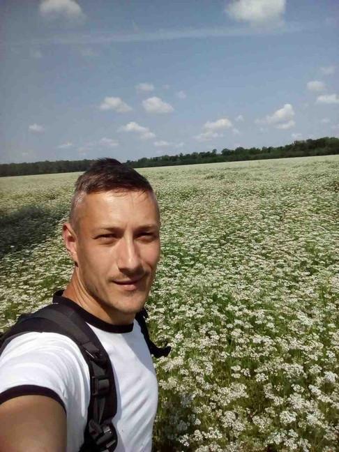 Yurii in buckwheat field