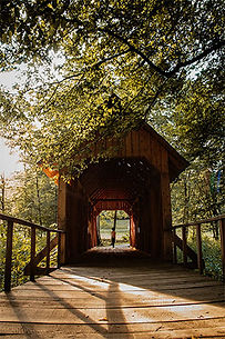 A wooden bridge with shelter