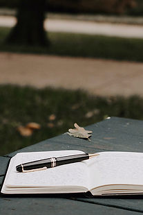 A journal and pen for writing