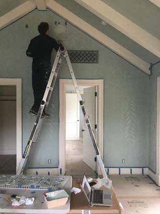 Stenciling walls.jpeg
