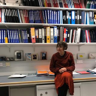 Jane in Gillian's freshly organised office.