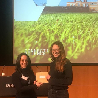 Miriam accepting joint first place for the poster prize at the CIMR Research Retreat, 2019