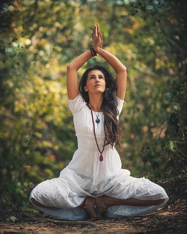 woman-squatting-on-ground-while-raising-