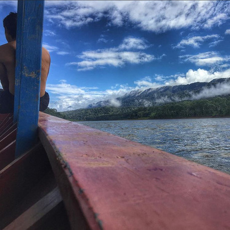On a boat on the Upper Madre de Dios River, heading to Parign Hak