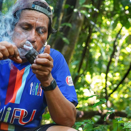 Alberto taking a break on one of the forest explorationswith his pipe