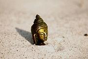 buddhaface in sand.jpg