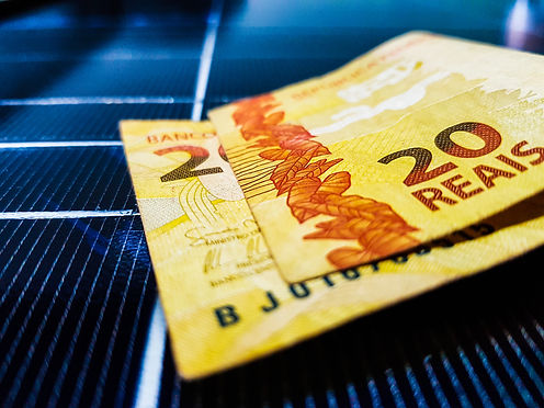 Money above Solar Panel. Notes of Reais
