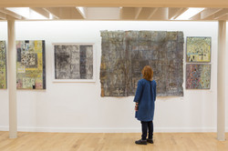 Liz in front of her exhibition