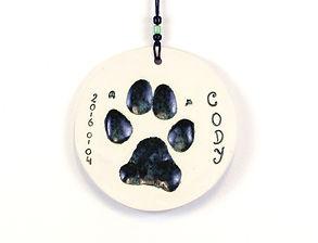 Tassavtryck på hund i lera/keramik