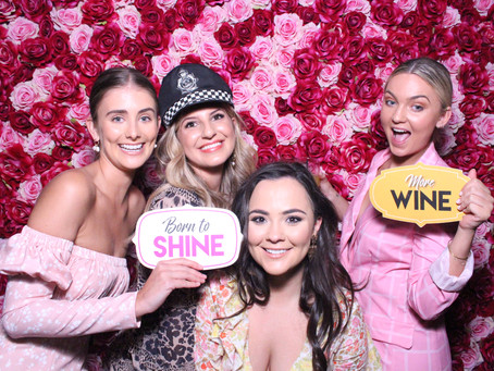 Hire an amazing photobooth with a Flower Wall.