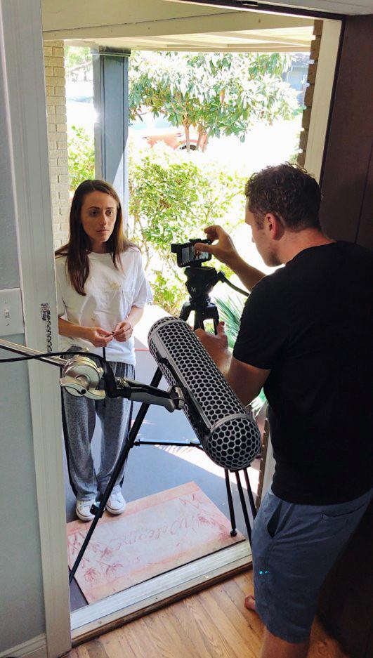Sean LaFollette filming Chiara McCarty on iPhone Xs