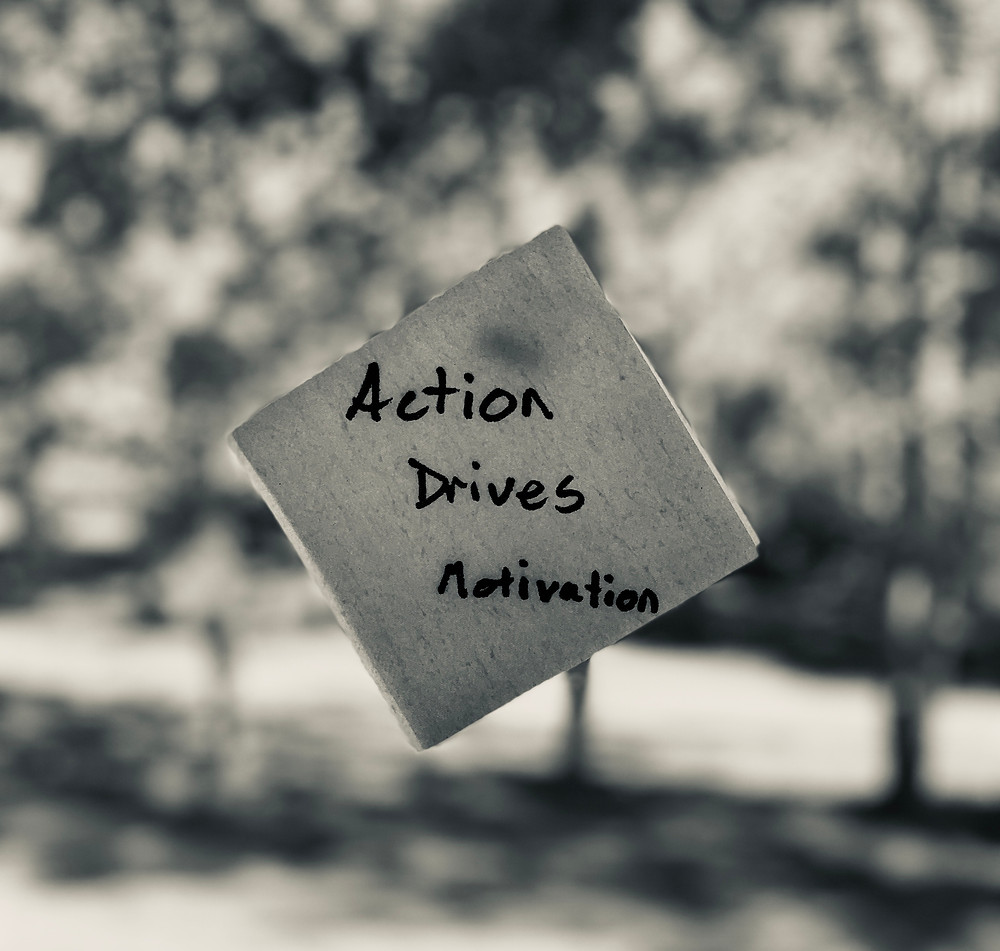 Napkin says Action Drives Motivation