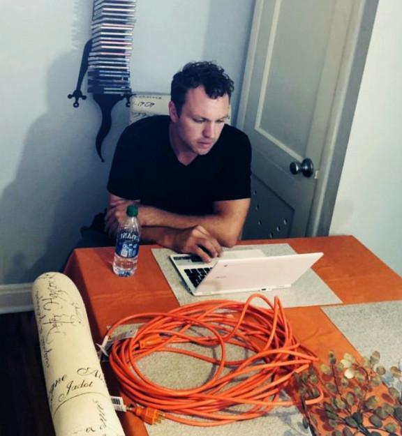 Sean LaFollette reviewing the script
