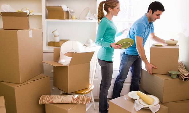 couple-unpacking-surrounded-by-boxes.jpg