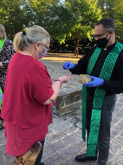 Fr. Chris Communion pets.jpg