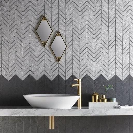 black and white chevron tile bathroom wall