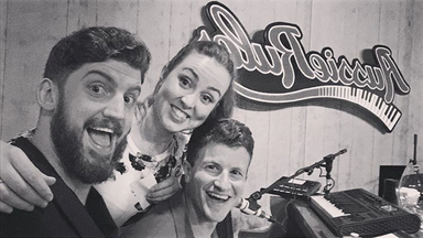 Katie Perman, Spenser Poole and Sean Sonego performing with The Grand Dueling Piano Show in Edmonton