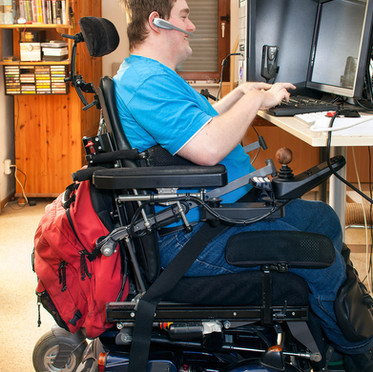 man-in-wheel-chair-using-computer.jpg