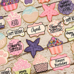 Loved this fun set!  Dog day at the beach for April's 40th Birthday! ___________#customcookies #deco