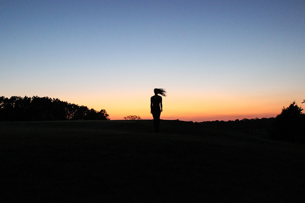 Image of silhouette against sunset. Ruth A-D