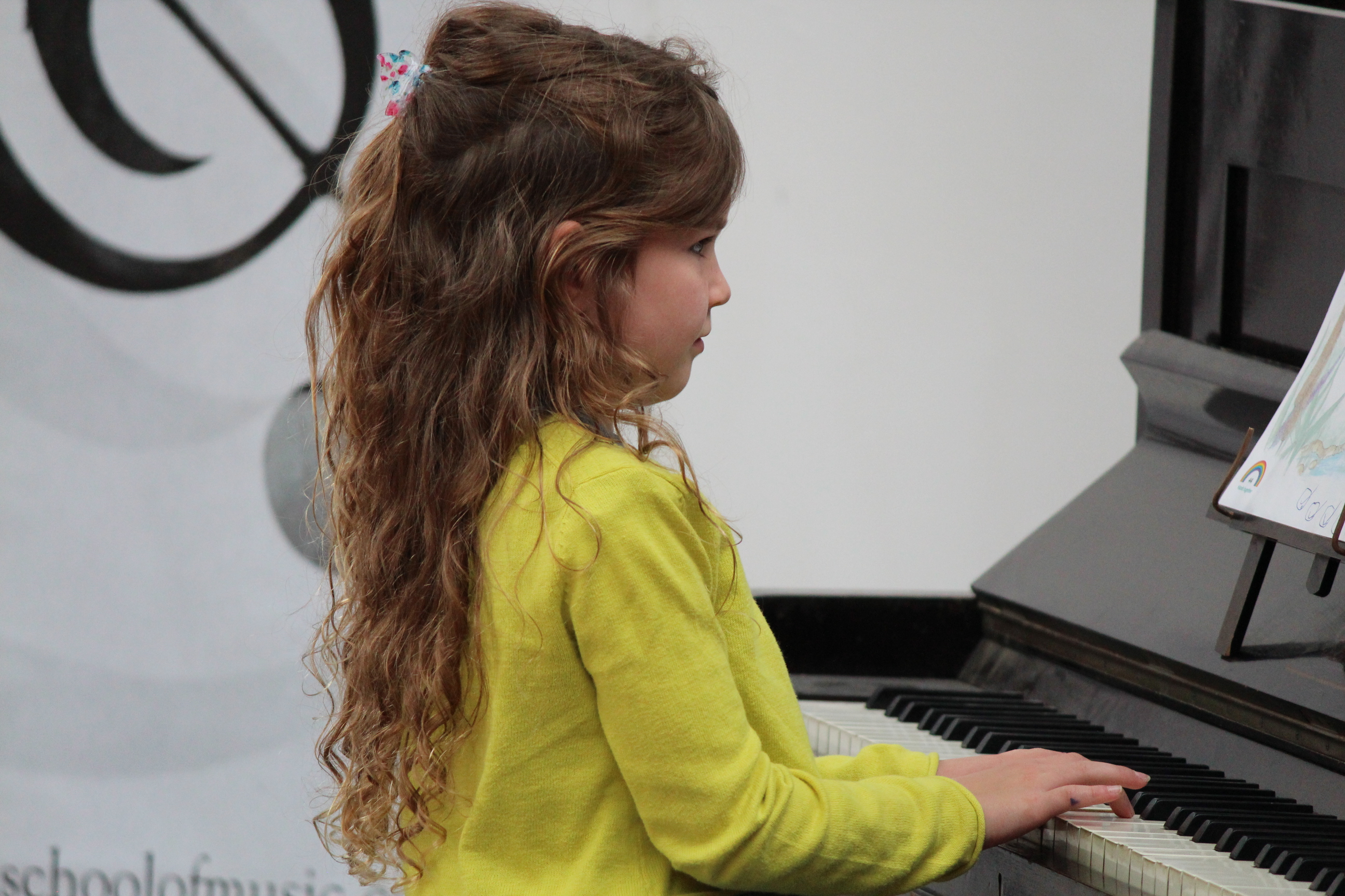 Young ESM student playing piano