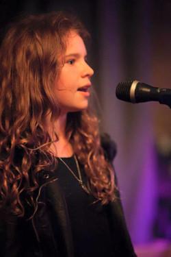ESM student singing in performance