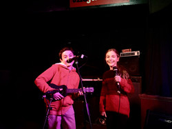 2 students performing at a showcase